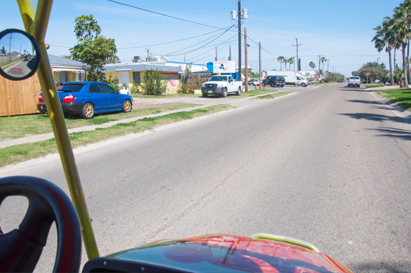 cart driving down the street in Port A, representing the importance of knowing the Port Aransas golf cart rules.