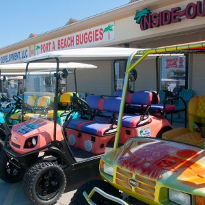Golf cart rentals in front of Port A Beach Buggies in Port Aransas