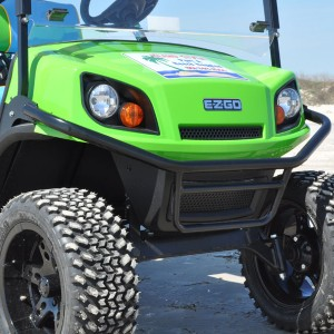 Bright green rental golf cart from Port A Beach Buggies